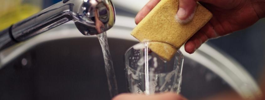 washing dishes with sponge